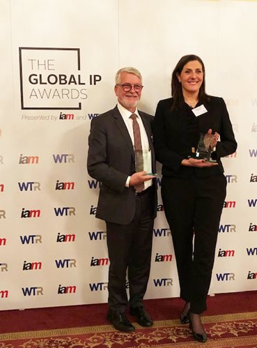 Photograph of Scott Jolliffe and Monique Couture wth the Russia - IP Firm of the year award trophy
