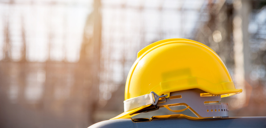 yellow construction helmet in construction site