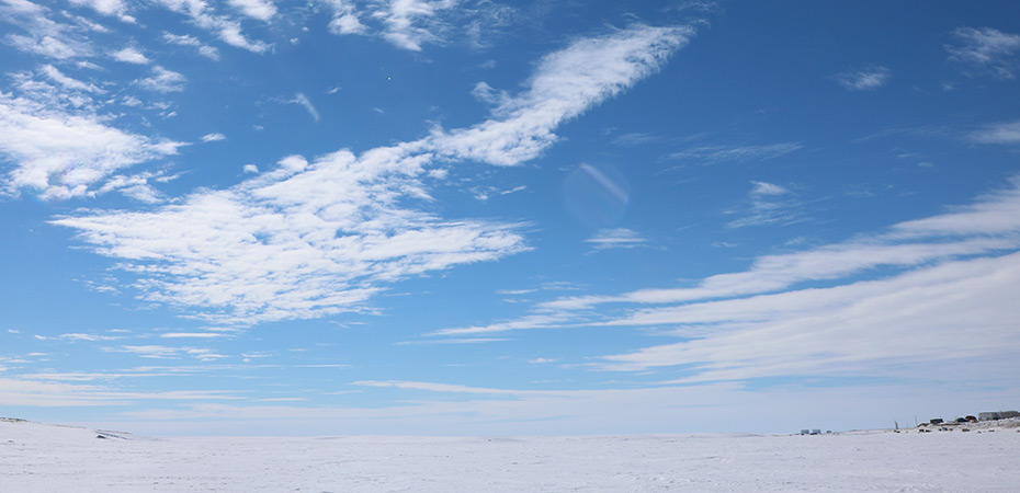 wide view of snow field and beautiful sky
