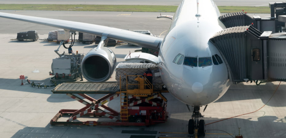Loading cargo on plane in airport.