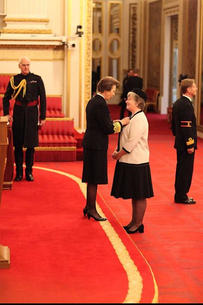Mary Thomson is made a Lieutenant of the Royal Victorian Order by Princess Anne at Buckingham Palace.